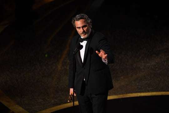 """Joaquin Phoenix recalled a lyric written by his older brother, the late musician River Phoenix, in his best actor acceptance speech for """"Joker."""""""
