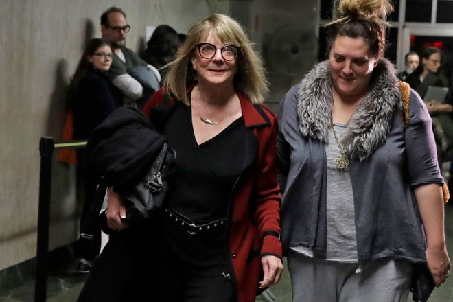 Psychologist Elizabeth Loftus, left, leaves the Harvey Weinstein rape trial, in New York,  Feb. 7, 2020.