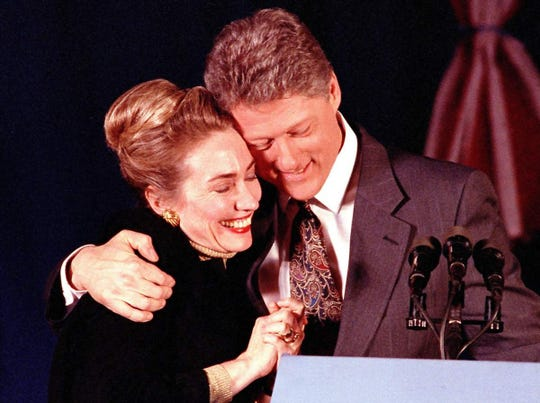 "Then-Arkansas Gov. Bill Clinton hugs his wife Hillary at his election night party in New Hampshire in 1992. Clinton finished second to Paul Tsongas, but his strong showing led him to declare himself the ""Comeback Kid."""