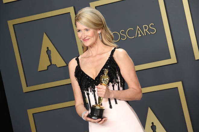 """Laura Dern, winner of the award for best performance by an actress in a supporting role for """"Marriage Story"""" poses in the photo room during the 92nd Academy Awards."""
