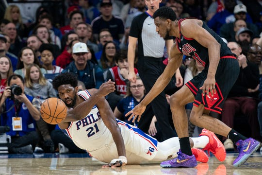 Philadelphia 76ers center Joel Embiid dives to knock the ball away from Chicago Bulls forward Thaddeus Young during the second quarter at Wells Fargo Center.