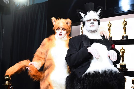Rebel Wilson and James Corden got playful backstage in cat costumes during the 2020 Oscars.