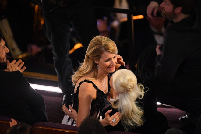 """Laura Dern is congratulated by her mother Diane Ladd as she accepts the award for best performance by an actress in a supporting role for her role in """"Marriage Story"""" during the 92nd Academy Awards."""