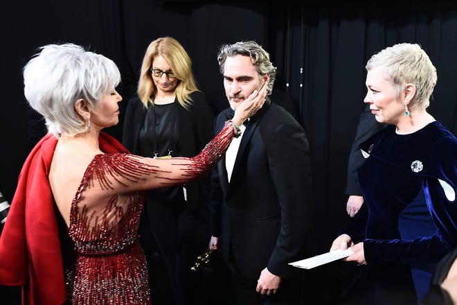 A sweet moment between Jane Fonda and Joaquin Phoenix after Phoenix wins best actor at the 2020 Oscars.