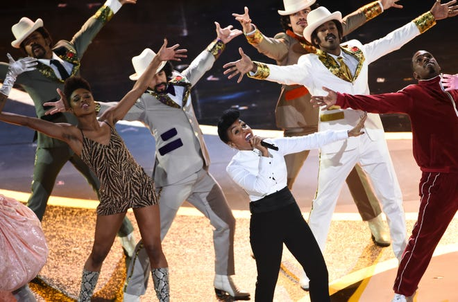 Janelle Monae performs at the Oscars on Sunday at the Dolby Theatre in Los Angeles.