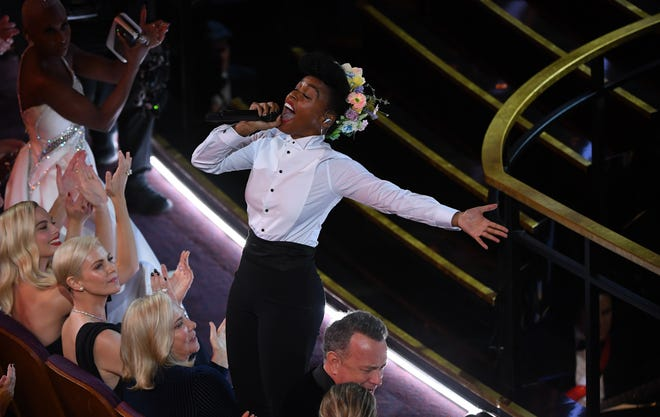 """Janelle Monae opened the Oscar telecast with a song honoring the year in film, from """"Midsommar"""" to """"A Beautiful Day in the Neighborhood."""""""