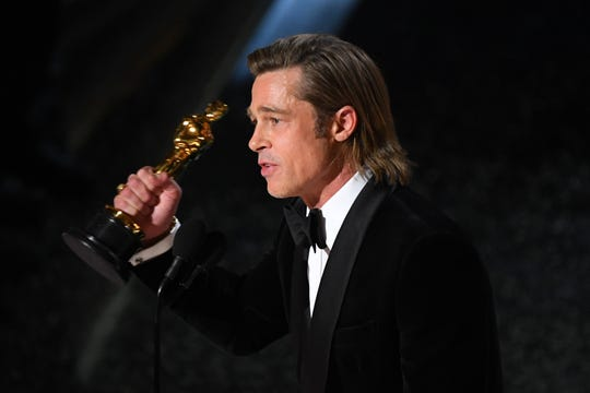"""Brad Pitt accepts the award for best performance by an actor in a supporting role for """"Once Upon a Time in Hollywood."""""""