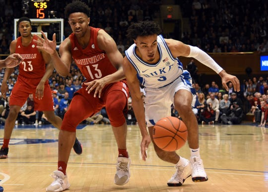 Duke Blue Devils guard Tre Jones (3) steals the ball from Louisville Cardinals guard David Johnson (13) during the first half at Cameron Indoor Stadium.