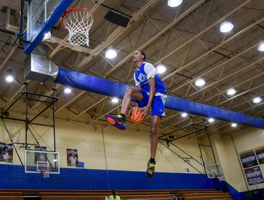 Bryce McGowens of Wren High School dunks at the end of practice in Piedmont Monday. McGowens committed to play at Florida State, an ACC opponent of his older brother Trey McGowens at Pitt.