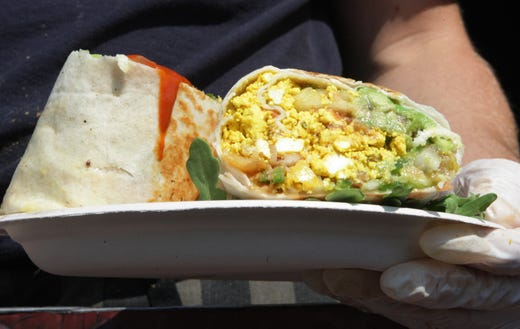 Breakfast Burritos with scrambled tofu, refried beans, pico de gallo, and avacado prepared at the Cinnamon Snail, vegan, organic, food truck at the farmers market in Red Bank in 2012.