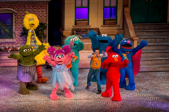 "Oscar, Big Bird, Abby, Rosita, Cookie, Elmo and Super Grover all take the stage in ""Sesame Street Live."""