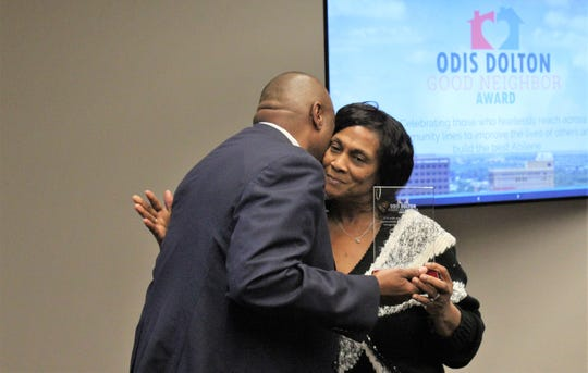 Pamela Dolton hugs Mayor Anthony Williams are receiving the first Odis Dolton Good Neighbor Award, named for her late husband who worked for the city of Abilene and was hailed a community advocate. The award, which will be presented annually, was announced at Monday evening's State of the City address.