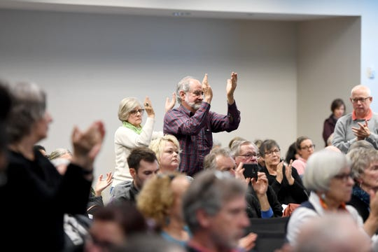 The crowd gives a standing ovation after a letter from public officials concerning Mission Health is read during a public meeting with the independent monitor of HCA, Gibbins Advisors, at MAHEC on Feb. 10, 2020.