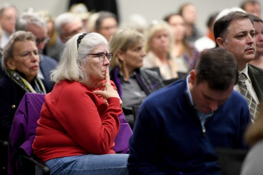 The crowd listens as a letter from public officials concerning Mission Health is read during a public meeting with the independent monitor of HCA, Gibbins Advisors, at MAHEC on Feb. 10, 2020.