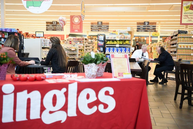 At right, Carroll Coleman, meat merchandizer with Ingles Markets, talks with Earth Fare employee Steven Howard as he hires him to work in the meat department during a hiring event for Earth Fare employees at the Ingles location on Hendersonville Road in South Asheville on Feb. 11, 2020. Hiring Events are being held at different Ingles stores to offer opportunities to current Earth Fare employees who are losing their jobs as the grocery chain closes down.