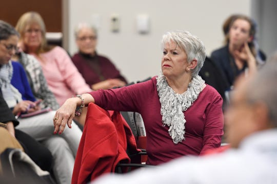 Alexandra Kiefer listens to the stories of others during a public meeting with the independent monitor of HCA, Gibbins Advisors, at MAHEC on Feb. 10, 2020.