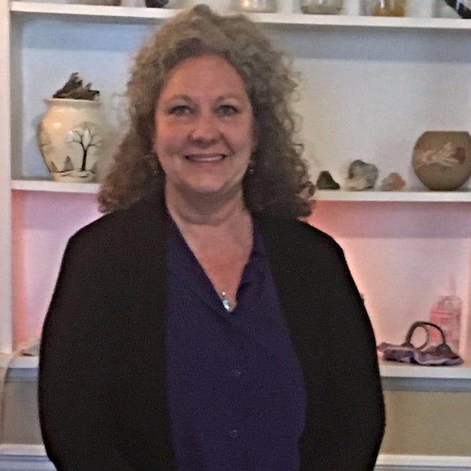 Lori Beasley, Reiki master.