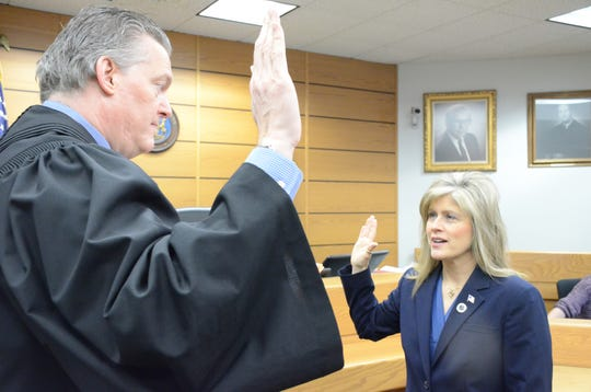 Calhoun County Chief Judge Michael Jaconette administers the oath of office to Kimberly Hinkley, who was selected county clerk/register to complete the term of retired Clerk Anne Norlander.