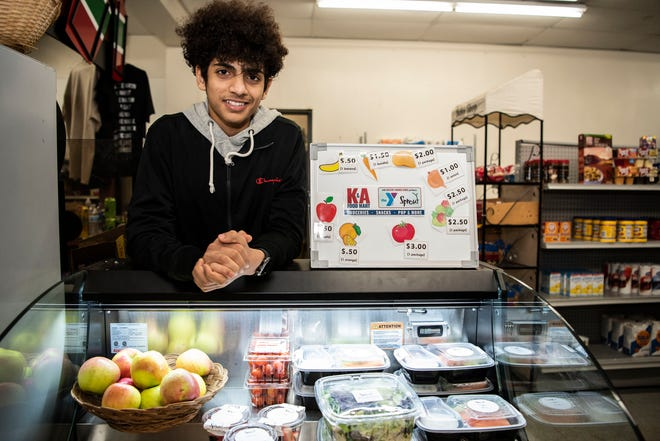 Battle Creek Central sophomore Ahmed Ahmed sells veggies, fruits and fresh produce at K&R Convenient Store, owned by his brother, on Monday, Feb. 10, 2020 in Battle Creek, Mich. Ahmed created the business in order to bring healthy, accessible food to his neighborhood.