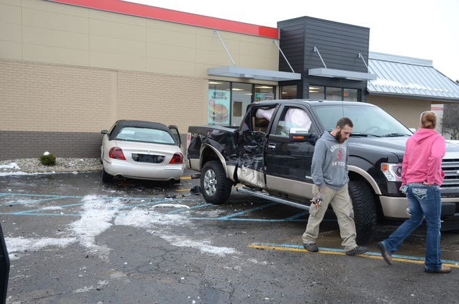 One man was taken to the hospital after his car drove across a parking lot and struck a pick-up and then the Burger King Restaurant at 575 North Ave. on Monday.