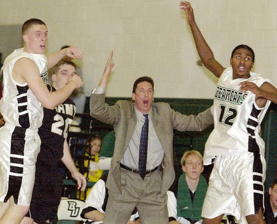 Binghamton University's Head Men's Basketball Coach Al Walker, center, gets upset by a call while Binghamton's Jeff Daws, from left, Army's Andy Smith and Binghamton's Gabe Martin, look at the referee during the first half of a 72-55 Bearcat win on Jan. 11, 2001. It was the first win over a Division I program for the men's basketball program.