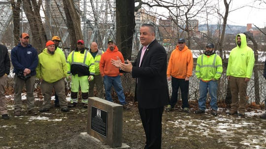 Binghamton Mayor Richard David unveils a memorial for Parks Department employee Donald Burton Sr., who died Feb. 11, 1970 while clearing the Exchange Street bridge of snow and ice. The memorial marked 50 years since his death.