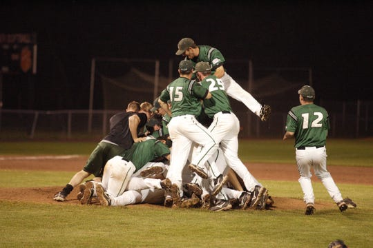 Binghamton University players, including John Miele (15) and Murphy Smith (25), celebrate their 16-6 victory against the University at Albany in the America East championship game on May 24, 2009. The game ended at 3:06 a.m. Sunday after several delays and the victory gained the Bearcats an automatic berth into the NCAA Division I baseball tournament.