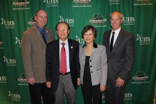 From left, Binghamton University Director of Athletics Patrick Elliot, Dr. Bai Lee, Dr. Jung Yum and Binghamton University President Harvey Stenger pose in October 2015. From left, Binghamton University Director of Athletics Patrick Elliot, Dr. Bai Lee, Dr. Jung Yum and BU President Harvey Stenger following a news conference in the Events Center.