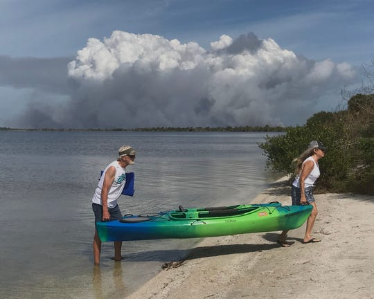 A controlled burn at the Merritt Island Wildlife Refuge is visible in the background Feb. 11, 2020.