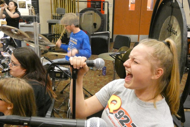 Taisha Spears sings as the Bucyrus High School Xband rehearses Monday in preparation for the Tri-C High School Rock Off at the Rock & Roll Hall Of Fame in Cleveland on Saturday.