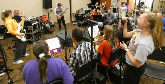 The Bucyrus High School Xband rehearses Monday in preparation for the Tri-C High School Rock Off at the Rock & Roll Hall Of Fame in Cleveland on Saturday.