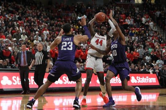 Feb 10, 2020; Lubbock, Texas, USA;  Texas Tech Red Raiders guard Chris Clarke (44) keeps the ball from Texas Christian Horned Frogs forward Jaedon Le Dee (23) and forward Diante Smith (10) in the second half at United Supermarkets Arena. Mandatory Credit: Michael C. Johnson-USA TODAY Sports