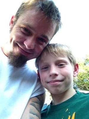 Tim Reynolds, left, and his son Sam Reynolds. Sam, 16, was killed Thursday, Feb. 6, 2020 in Arlington, Texas. A juvenile is in custody in connection with the shooting.