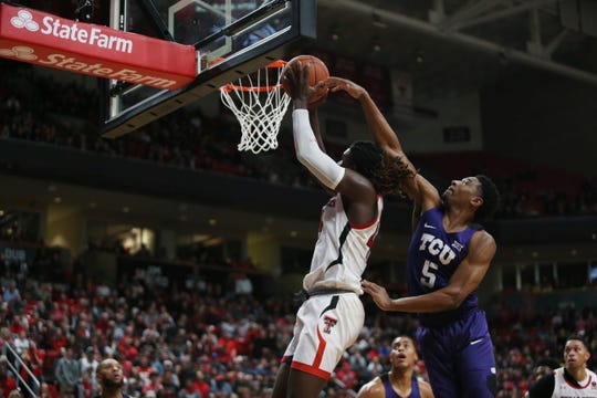 Feb 10, 2020; Lubbock, Texas, USA;  Texas Christian Horned Frogs guard Jaire Grayer (5) tries to block a shot by Texas Tech Red Raiders guard Chris Clarke (44) in the second half at United Supermarkets Arena. Mandatory Credit: Michael C. Johnson-USA TODAY Sports