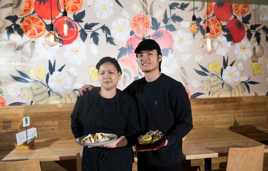 Mark Reyta and his mother Everlinda Reyta, chefs/owners of Reyta's Filipino Cuisine, stand in the dining room of Reyta's Filipino Cuisine in Cherry Hill.
