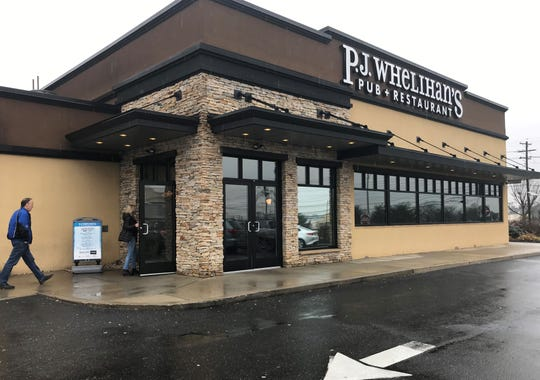 Patrons enter a P.J. Whelihan's on Lenola Road in Maple Shade Tuesday.