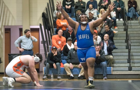 Williamstown's Deonte Hall celebrates after defeating Cherokee's Aidan Geisenberger, 4-2, during the 285 lb. bout of the opening round match of the South Jersey Group 5 wrestling tournament held at Williamstown High School on Monday, February 10, 2020.