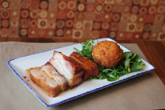 Maple-glazed pork belly is one of the Colonially-based dishes offered at George & Martha's  American Grille in historic Morristown.