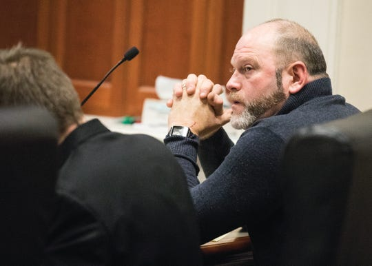 Mark Detty, who is on trial for rape and gross sexual imposition, listens as his accuser is questioned by prosecuting attorney Cynthia Schumaker on Feb. 11, 2020. Detty is charged with several counts of sexual battery and rape that allegedly occurred between 1999 and 2003.