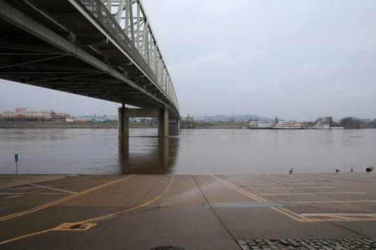 View of the Taylor-Southgate Bridge as a parking lot underneath is closed, Tuesday in Cincinnati. The river is at 44.94 feet as of Tuesday morning and is expected to approach flood stage by Saturday morning, according to the National Weather Service Advanced Hydrologic Prediction Service.