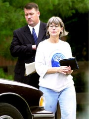 JUNE 24, 2000: Paige Smith, the wife of George Gibson, and Det. Mike Quinn of the West Chester Police Department had just toured the West Chester home were Gibson was killed.