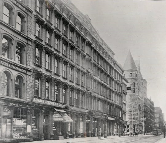South side of Fourth Street, near Vine, in 1890. Pike's Opera House, and beyond it the castle-like Chamber of Commerce Building.