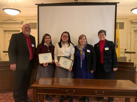(Left to right) Richard Jakubowski, Mother Seton's engineering teacher; Viviana Arbelaez, senior; Rachel Amarille, junior; Mary McElroy, assistant superintendent of schools in the Archdiocese of Newark; and Sister Jacquelyn Balasia, principal of MSR, smile with pride as the students receive their certificates of award.