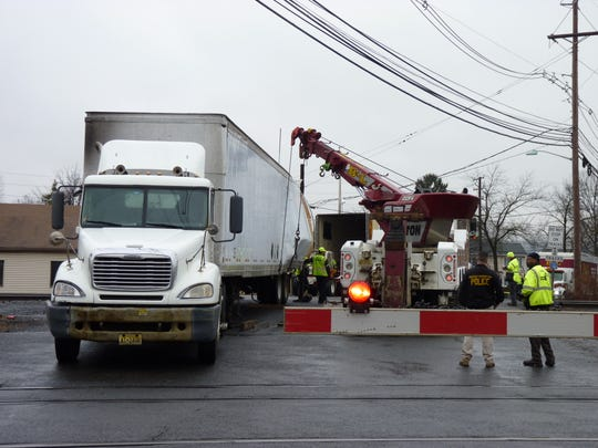 An NJ Transit passenger train struck a tractor-trailer at the Cedar Avenue crossing in Middlesex Borough on Feb. 11, making it the third train-involved accident at the crossing in less than two months.