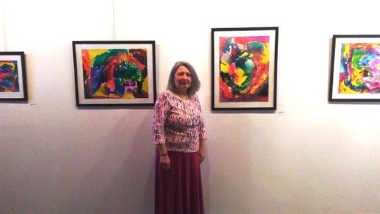Monica Schraiber Otero is shown with her paintings at the Watchung Arts Center.