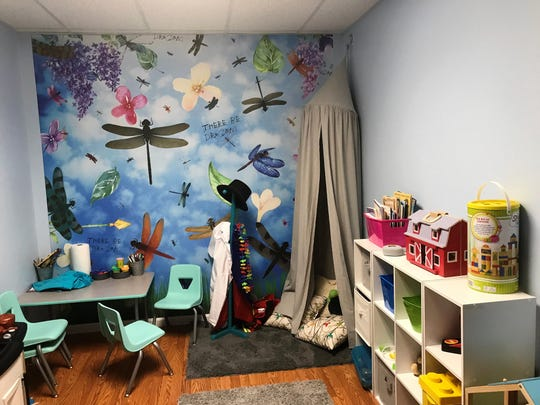 A Parent-Child Interaction Therapy room at the new Flight School of Coshocton Behavioral Health Choices allows a counselor to view parents and kids playing and interacting through a one-way mirror and provide advice as needed.