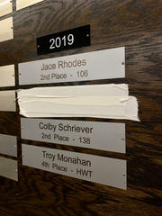 As a junior, Mason City's Cullan Schriever placed sixth at the state tournament after defaulting out due to an injury. Inside the Mason City wrestling room, he covered up his sixth-place nameplate on the Wrestling Hall of Fame wall with athletic tape.