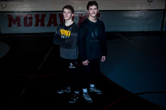 Cullan and Colby Schriever, twins and senior wresters for Mason City, pose for a photo in the Mohawk's wrestling room on Monday, Feb. 10, 2020, in Mason City. The pair will both join the University of Iowa wresting team in the fall.