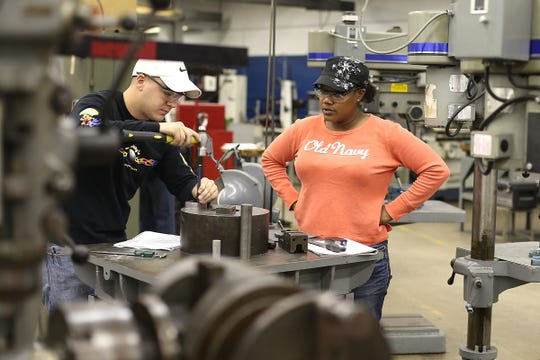 Tamica Allison works on a project in the industrial lab at Hawkeye Community College in Waterloo in 2013.