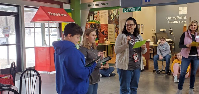 Woodside Middle School Teacher Anne DaLuga is pictured here at Junior Achievement BizTown introducing Isaiah Thayer as JA BizTown District Attorney and Zoe Beebe as JA BizTown Mayor.